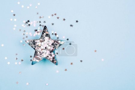 Star with sparkles on blue background