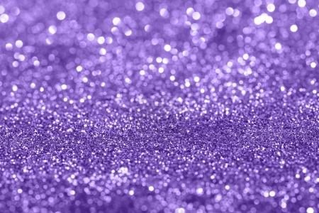 Glamour Ultra Violet sparkling background. Blured glitter background with blinking stars. Holiday abstract texture.
