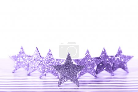 Textured glittering Ultra Violet stars on white background. Demonstration of color of the year.