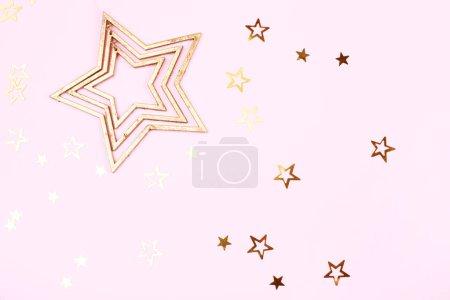 Golden stars on pink background
