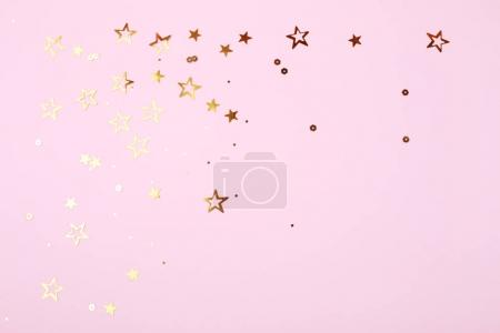 Golden stars on pink background