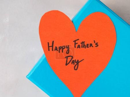 Blue box present with paper red heart hand written...
