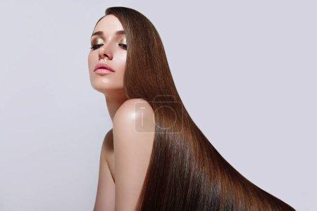 Very long, straight silky hair.