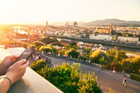Atourist with a mobile phone in Florence Italy