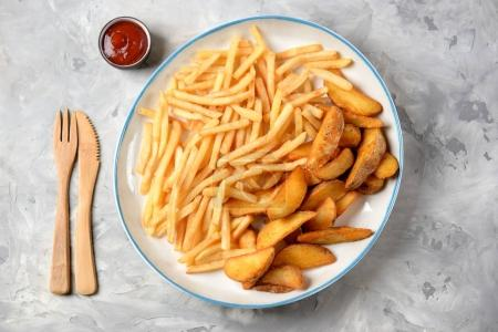 French fries -  potato stick and potato wedges in ...