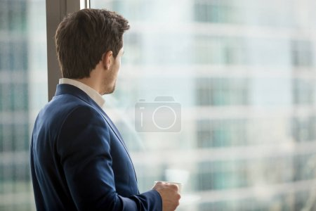 Businessman thinking about decision in office