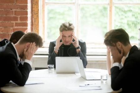 Stressed boss executive team searching