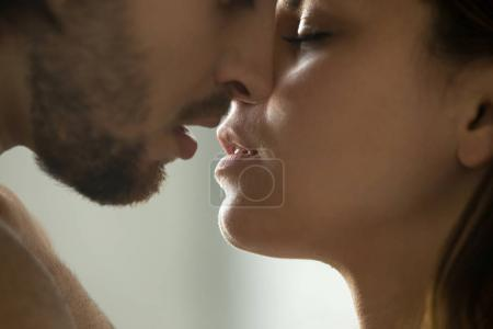 Sensual couple kissing faces and