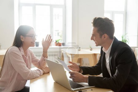 Photo for Hr and applicant laughing during successful job interview, happy vacancy candidate talking to smiling recruiter discussing winning resume making good first impression, recruitment and hiring concept - Royalty Free Image
