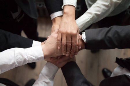 Motivated business people put hands together, sale...