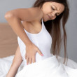 Upset young woman sit in bedroom suffering from ba...