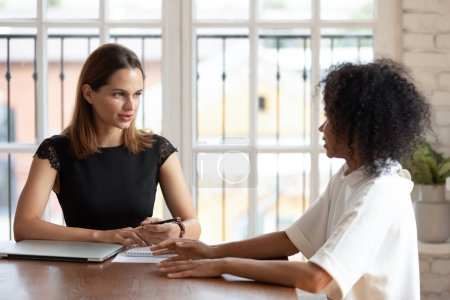 Confident businesswoman hr manager holding interview with African American woman