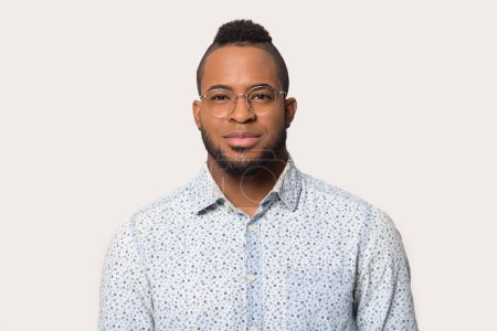 Photo for Portrait of African American male in floral shirt wearing glasses stand posing isolated on grey background, headshot picture of young biracial man in spectacles and casual clothes look at camera - Royalty Free Image
