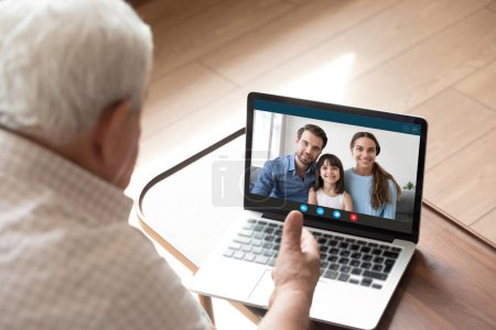 Mature grandfather have online talk with smiling relatives