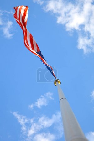 American flag in the blue sky