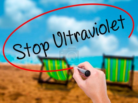 Photo for Man Hand writing Stop Ultraviolet with black marker on visual screen. Isolated on sunbed on the beach. Business, technology, internet concept. Stock Photo - Royalty Free Image
