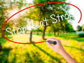 Woman Hand Writing Stop Heat Stroke with a marker over transpare