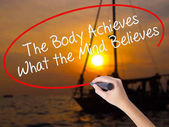 Woman Hand Writing The Body Achieves What the Mind Believes with