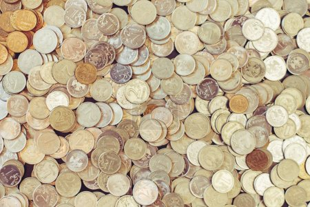 Background of gold and silver coins.