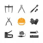 Construction tools glyph icons set Bearing puller ratchet construction gloves and scissors industrial safety helmet stapler plumb bob mitre box Silhouette symbols Vector isolated illustration