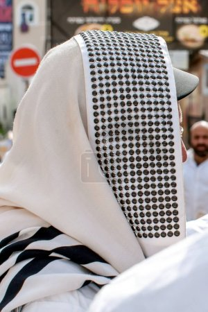 Orthodox hassidic Jew pray in a holiday robe and t...