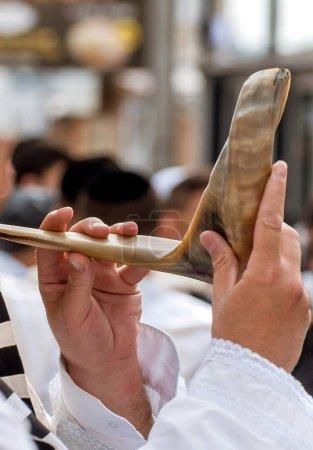 Jewish hasid blows Shofar....