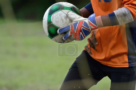 Goalkeeper running with holding ball