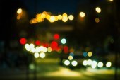 Beautiful abstract background with defocused buildings, cars, city lights, people