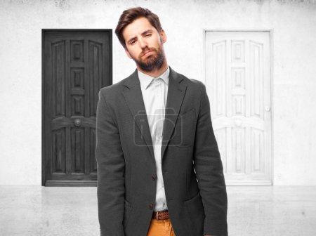 Sad businessman in boring pose