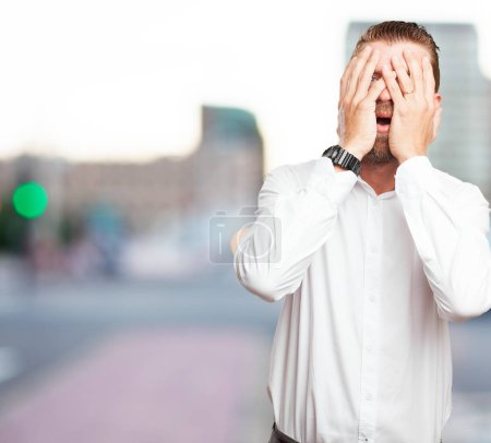 Photo for Worried young man covering face - Royalty Free Image
