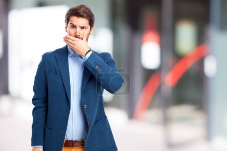 scared businessman covering mouth