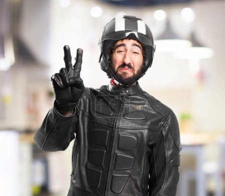 Photo for Sad biker with number two - Royalty Free Image