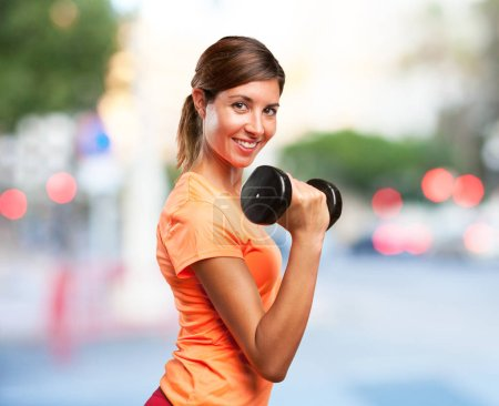 Strong sport woman with dumbbell...