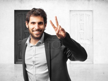 happy businessman with victory sign
