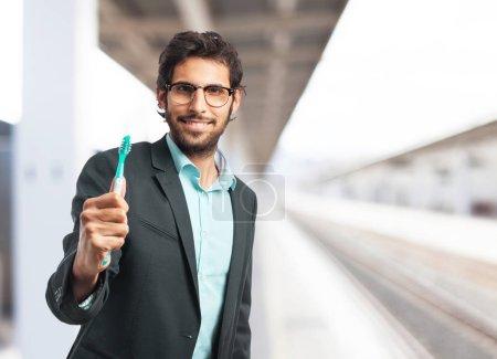 happy businessman with teeth brush
