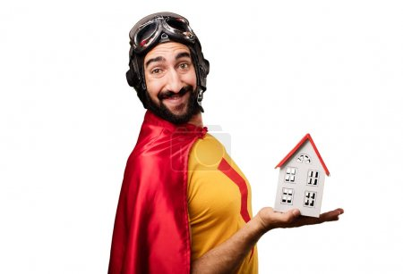 crazy super hero with a house model