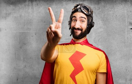 crazy super hero with victory sign