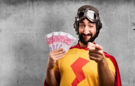 crazy super hero with 500 euro bills