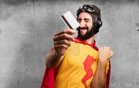 Crazy super hero with credit card