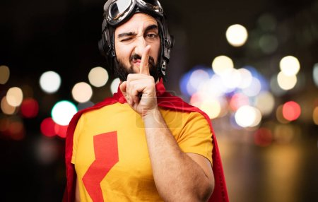 Crazy super hero with silence gesture