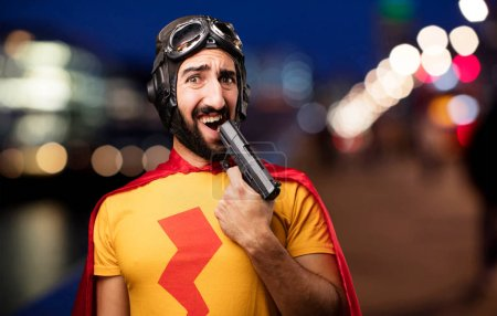 Crazy super hero with a gun