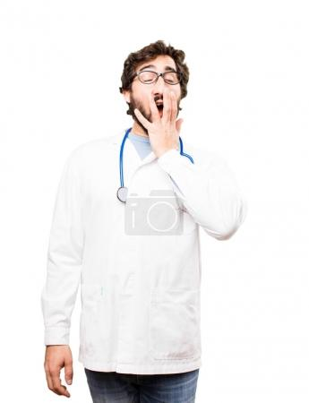 young doctor man yawning