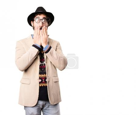 young cool hipster covering mouth
