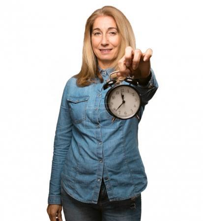 senior beautiful woman with a clock