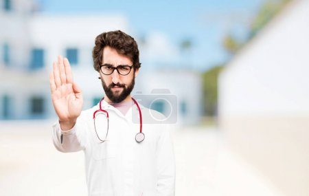 young doctor man with stop sign