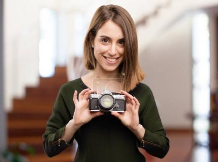 young pretty woman with a camera