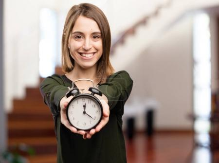 Photo for Young pretty woman with clock - Royalty Free Image