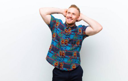 Photo pour Young blonde salope man wearing a cool shirt smiling positively and confidently, looking satisfied, friendly and happy against white background - image libre de droit