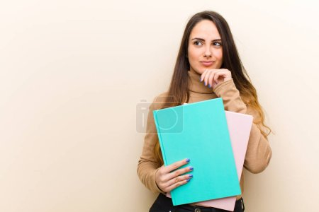Photo for Young pretty woman with books, student concept - Royalty Free Image