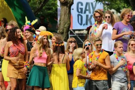Amsterdam, Netherlands - August 4, 2012: Participants at the famous Canal Parade of the Amsterdam Gay Pride